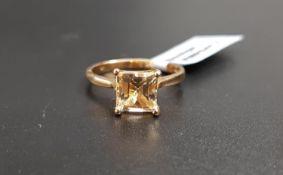 CERTIFIED IDAR GOLDEN BERYL RING the square cut beryl weighing 1.61cts, on nine carat gold shank,
