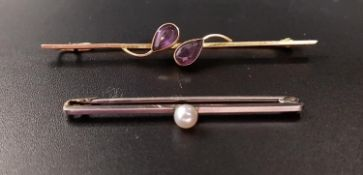 TWO NINE CARAT GOLD BAR BROOCHES one in white gold with central pearl, 4.3cm long; the other in rose