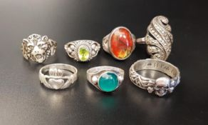 SEVEN VARIOUS SILVER RINGS including agate and stone set, a Claddagh example and one with skull
