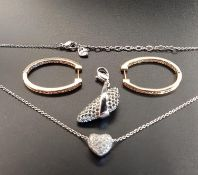SELECTION OF SWAROVSKI CRYSTAL JEWELLERY comprising a pair of gold tone hoop earrings, a heart