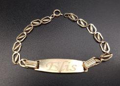 FOURTEEN CARAT GOLD IDENTITY BRACELET the central plaque engraved 'Elis', approximately 2.1 grams