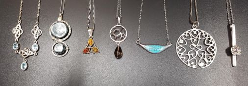 GOOD SELECTION SEVEN SILVER PENDANT ON SILVER CHAINS including an aquamarine set necklace with