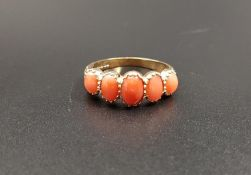 GRADUATED CORAL FIVE STONE RING the five oval cabochon coral sections on nine carat gold shank, ring