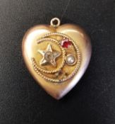 RED GEM AND SEED PEARL HEART SHAPED PENDANT in unmarked gold, decorated with star and crescent