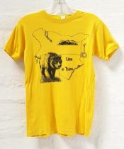 ALMOST FAMOUS (2000) - TWO T-SHIRTS comprising a YELLOW 'LION TSAVO' KENYA T-SHIRT, the yellow t-