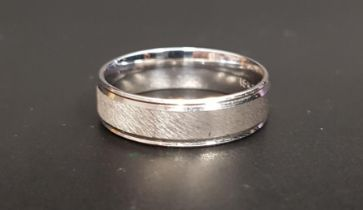 EIGHTEEN CARAT WHITE GOLD WEDDING BAND with brushed finish, by Frederick Goldman, ring size U and