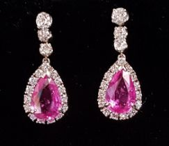 PAIR OF PINK TOPAZ AND DIAMOND DROP EARRINGS the central pear cut pink topaz on each approximately