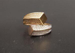 PAVE SET DIAMOND RING the multi diamonds in two tone fourteen carat gold twist setting, ring size