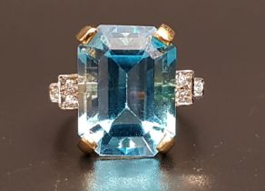 BLUE TOPAZ AND DIAMOND COCKTAIL RING the large emerald cut blue topaz measuring approximately 15.4mm