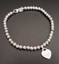 TIFFANY AND CO. SILVER BEAD BRACELET with return to Tiffany heart tag