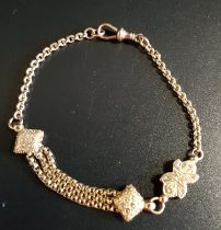 UNUSUAL NINE CARAT GOLD ALBERTINA BRACELET with central shaped links and triple chain section,