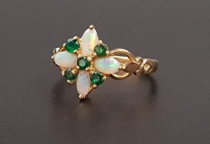 UNUSUAL OPAL AND EMERALD CLUSTER RING the four oval cabochon opals separated by round cut