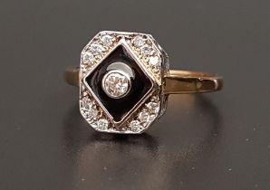 ART DECO STYLE DIAMOND AND BLACK ENAMEL RING the central bezel set diamond approximately 0.08cts