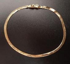 FOURTEEN CARAT GOLD FLAT SNAKE CHAIN BRACELET with safety clasp, approximately 2.8 grams