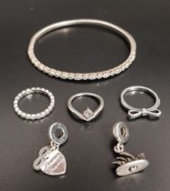 SELECTION OF PANDORA SILVER JEWELLERY comprising a Timeless Elegance Bangle, three rings -