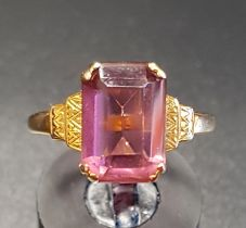 PINK GEM SET SINGLE STONE RING on nine carat gold shank with stepped shoulders, ring size P