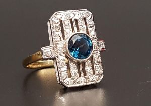 ART DECO STYLE BLUE TOPAZ AND DIAMOND RING the central round cut blue topaz approximately 1ct in