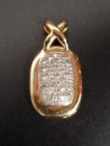 PAVE SET DIAMOND PENDANT of oval form with 'X' shaped suspension loop, in fourteen carat gold,