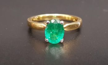 EMERALD SINGLE STONE RING the oval cut emerald approximately 1.2cts, on eighteen carat gold shank,