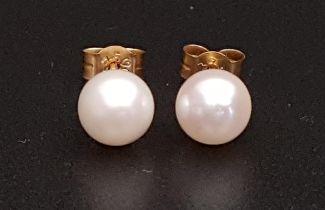 PAIR OF PEARL STUD EARRINGS the pearls approximately 6.2mm diameter, in nine carat gold