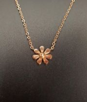 EIGHTEEN CARAT ROSE GOLD NECKLACE the floral pendant section with attached chain, approximately 2.