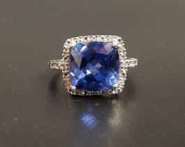 TANZANITE AND DIAMOND CLUSTER DRESS RING the central cushion cut tanzanite measuring approximately
