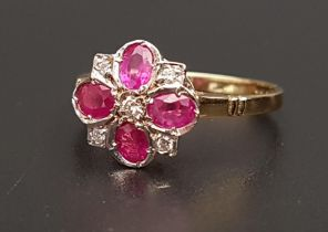 RUBY AND DIAMOND CLUSTER RING the four oval cut rubies separated by small diamonds, on eighteen