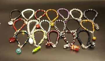 SELECTION OF BEAD BRACELETS all with silver clasps and glass bead charm attachments (18)