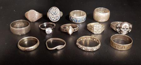 THIRTEEN SILVER RINGS of various designs including a German 1914 Vaterlands Dank ring, a Thai