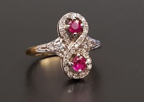 UNUSUAL RUBY AND DIAMOND RING the round cut rubies totaling approximately 0.35cts, within multi