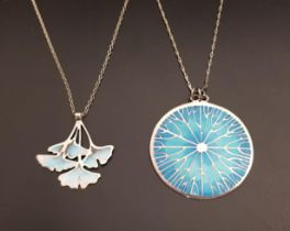 TWO NORMAN GRANT SILVER AND ENAMEL DECORATED PENDANTS one a Ginkgo pendant with pastel shades of