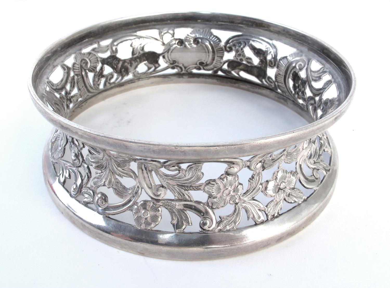 Irish silver miniature dish ring, of typical waisted form, pierced and repousse decorated with