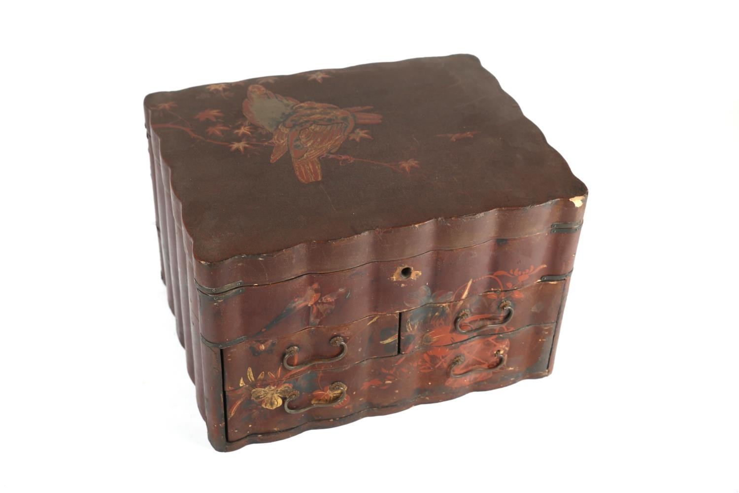A Meiji Japanese cinnabar lacquer tabletop jewellery chest, the hinged lid decorated with