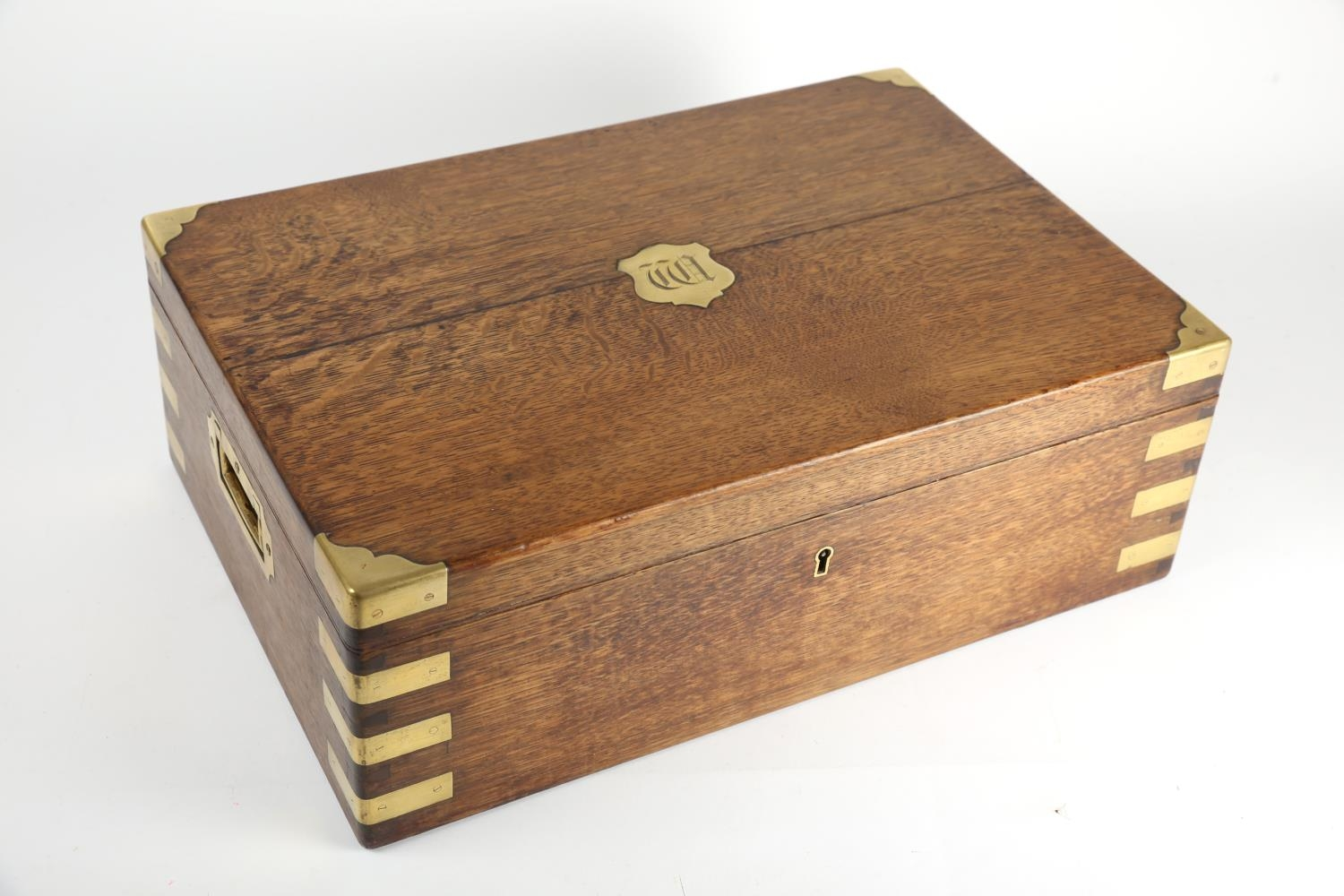 A 19th century brass-bound, oak military box, with recessed handles, the lid inset with a brass