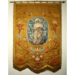 An early 20th century processional banner venerating St. Brigid. A gold silk brocade banner centered