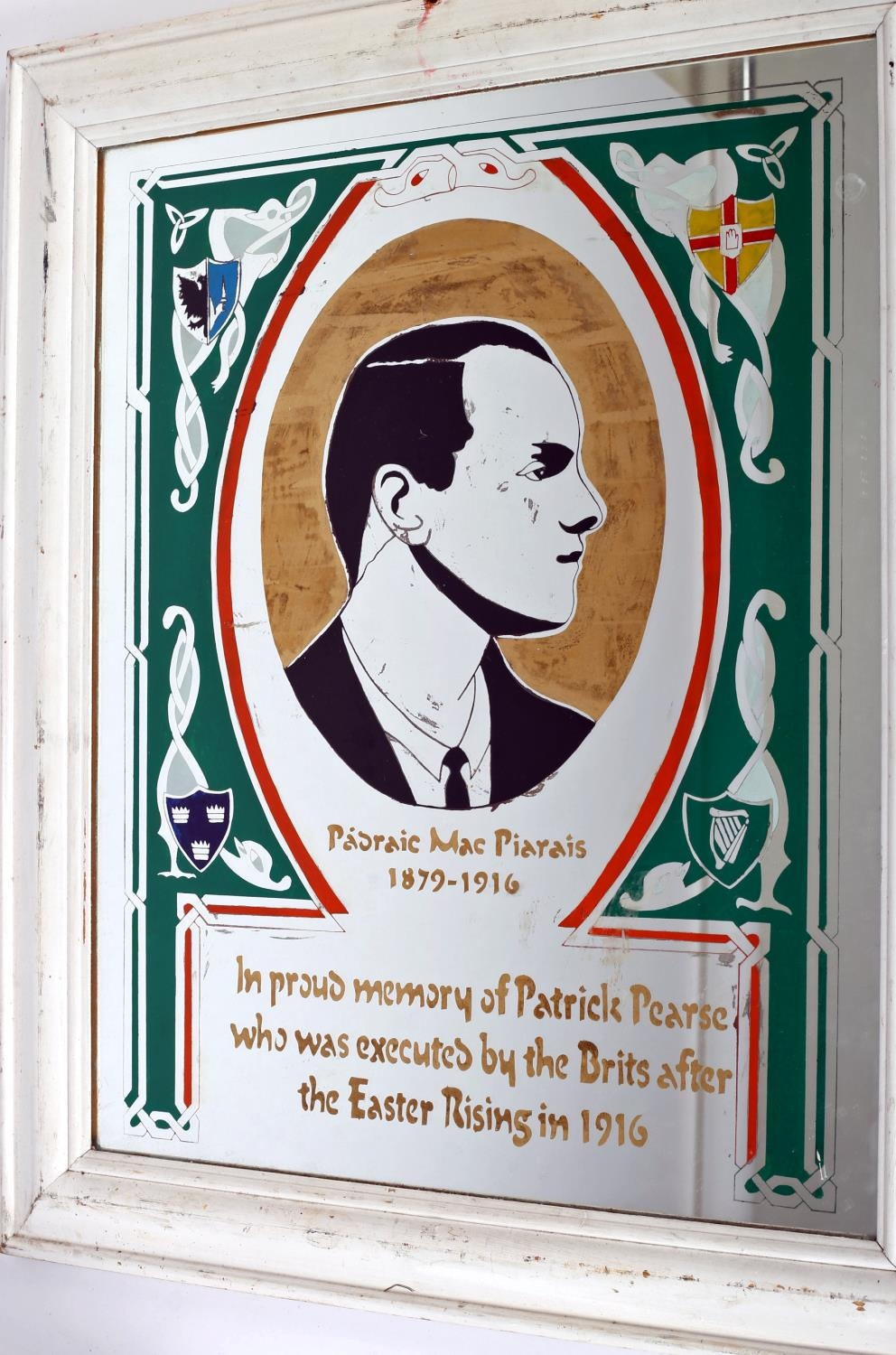 """Prisoner Art, mirror commemorating Padraig Pearse, centered with a portrait of Pearse and """"Padraig"""