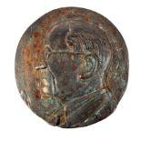 A bronze plaque of Éamon de Valera, the circular bronze plaque centered with a relief portrait bust,
