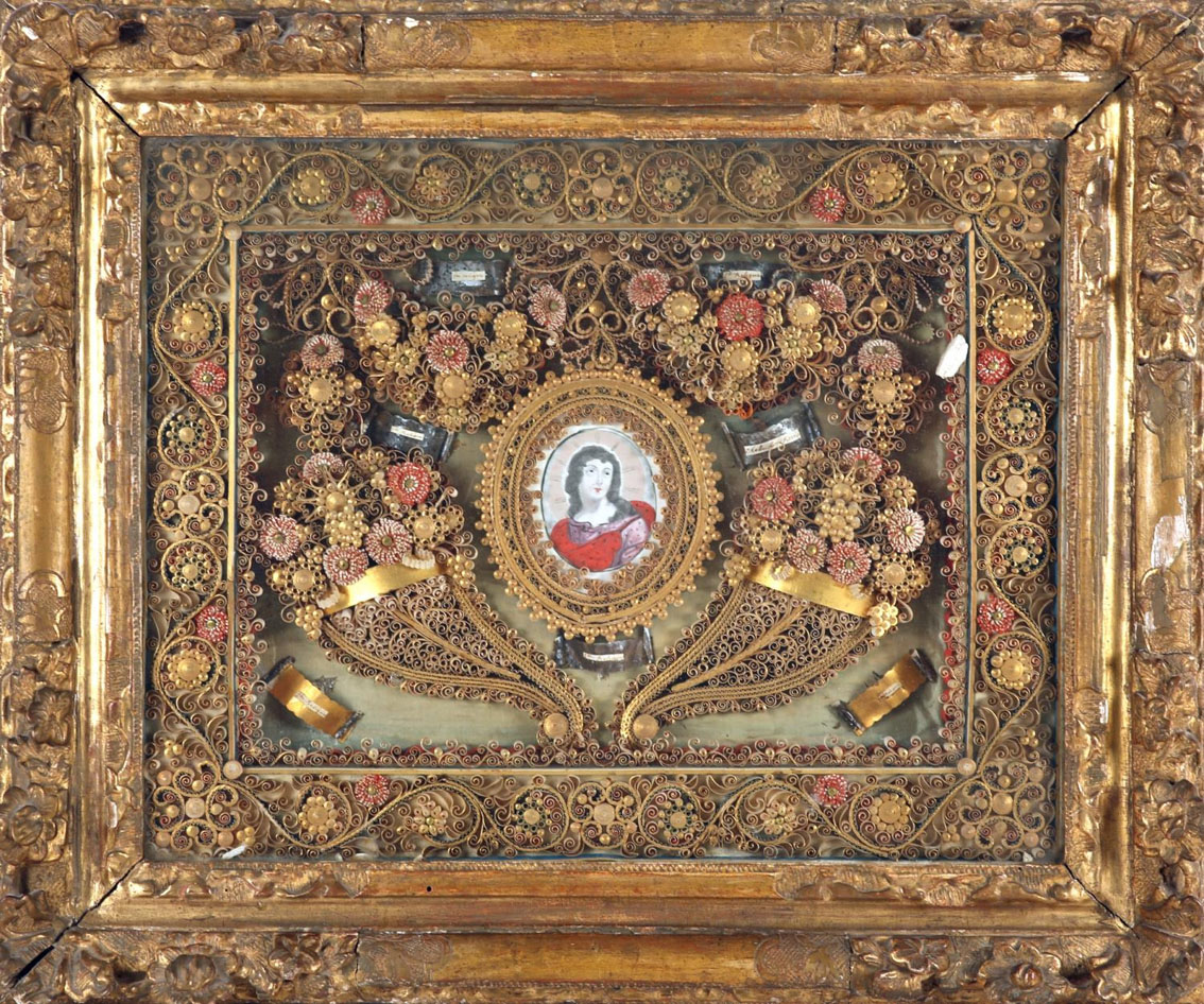 A late 18th/early 19th century, French, rolled paper reliquary, centered with an ink and wash