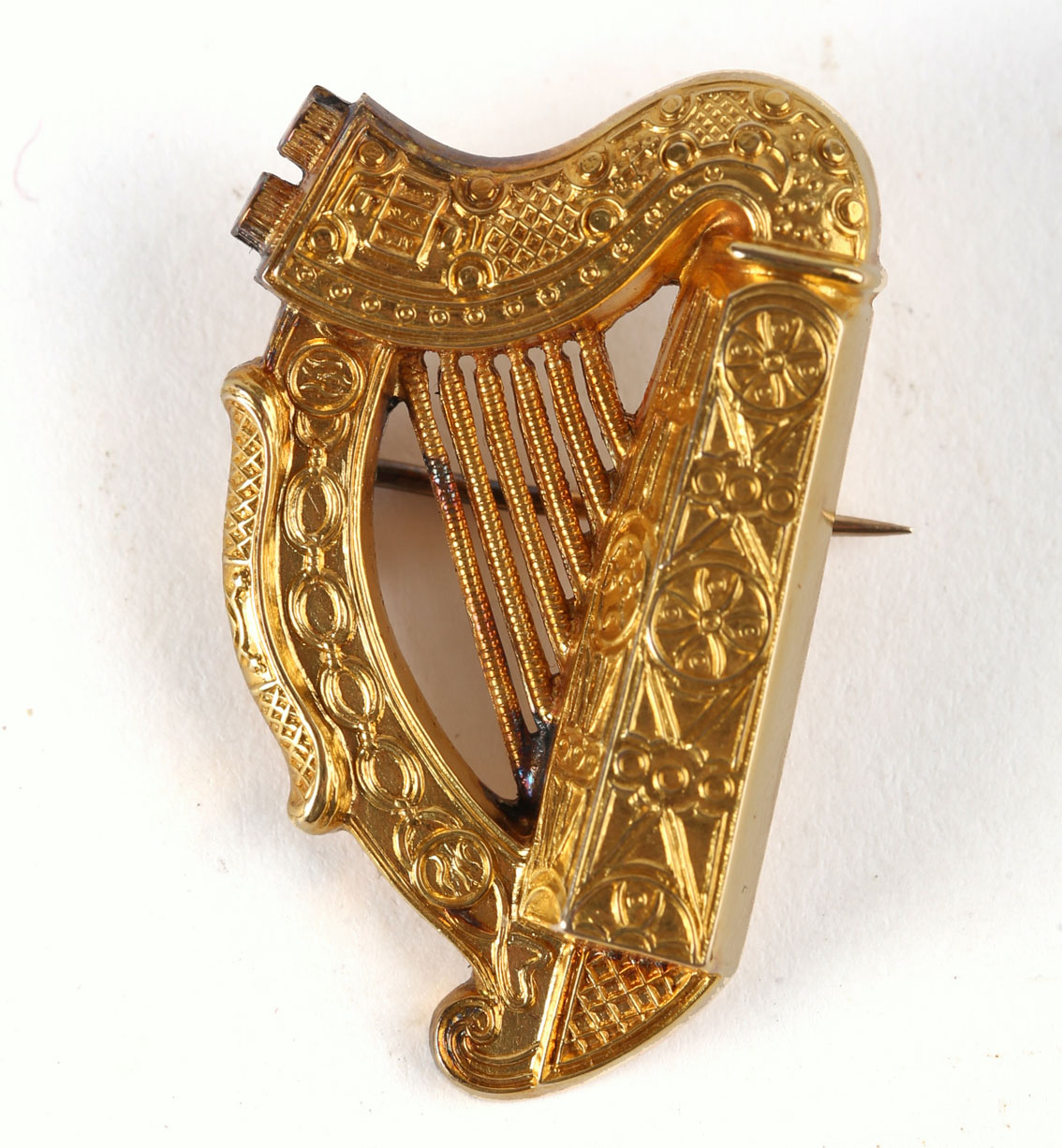 A Victorian Irish gold harp brooch by Hopkins & Hopkins, Dublin, modelled on the Trinity College