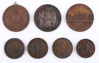 A collection of Irish educational award medals. A St Patrick's College, Carlow copper medal; The
