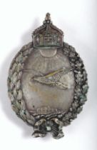 1914-1918 German Imperial sea plane pilot badge, a sea-bird soaring over a coastal seascape, beneath