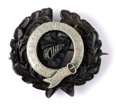Victorian Irish silver-mounted bog oak brooch, from the collection of the Hon. Garech Browne,