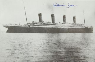 """Titanic survivor's autograph. An image of the Titanic signed in blue ink """"Millvina Dean""""."""