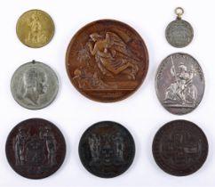 Irish exhibition medals. An 1865 Dublin International Exhibition bronze award medal awarded to E.
