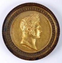Gilt medal commemorating Tsar Alexander I of Russia. Obverse shows laureate head of the Emperor, and