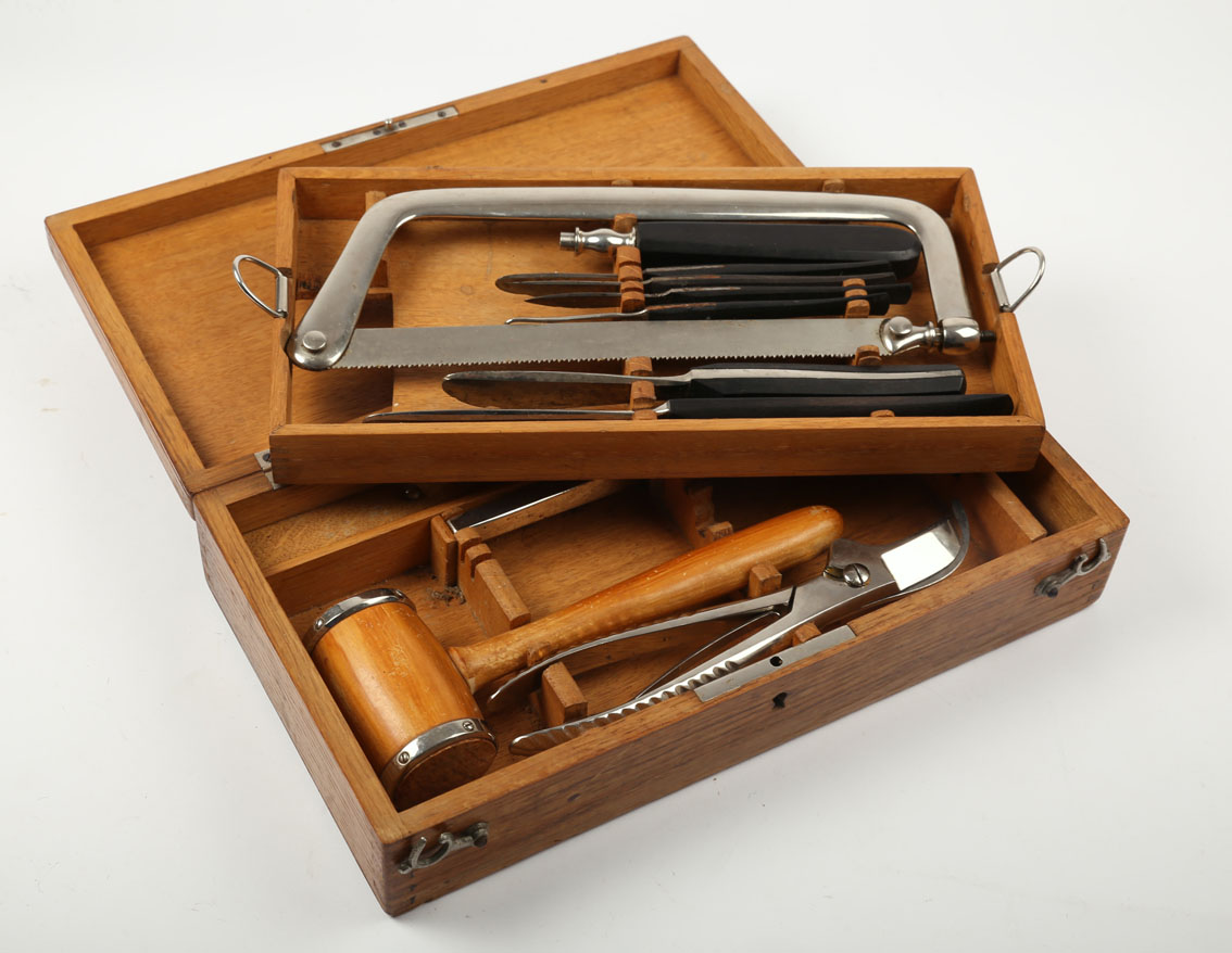 Surgeon's instruments. A pre-Lister set of surgeon's instruments, including amputation saw, chisels,