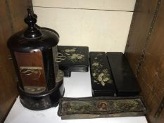SECTION 27. A black lacquered and painted circular cigar dispenser, decorated with birds amongst