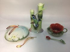 A 20th century ceramic poppy cup, saucer and spoon by Franz, designed by Kuei Mei and sculpted by