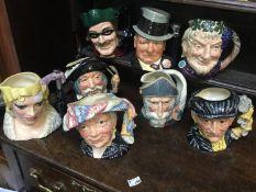 A selection of large Royal Doulton character jugs including Bacchus, Don Quixote, Sancho Panca,