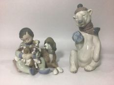 A Lladro porcelain figure 'Painful Bear No. 5021', 18.5cm high, together with a Lladro figure